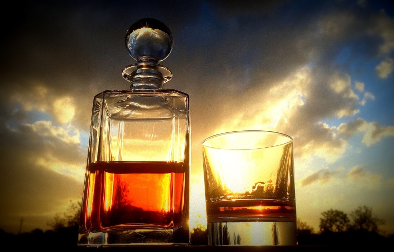 A decanter of whisky at sunset from my ongoing Instagram series titled #sunsetthroughbooze